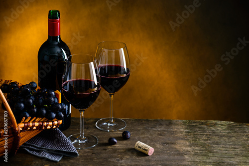 Still life with bottle of red wine, two wineglasses and grape in © smspsy