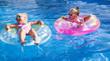 little pretty girls is swimming in pool