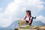 Woman hiker using map outdoor
