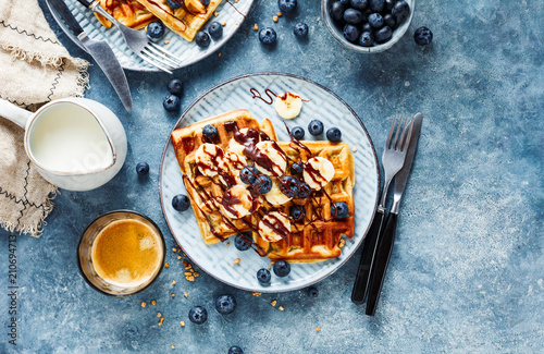 Delicious homemade waffles with banana - 210694713