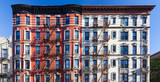 Panoramic view of old brick building against blue sky background in the East Village of Manhattan in New York City - 210697399