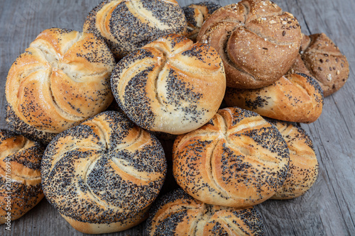 Fototapeta Beautiful bread; poppy seed roll, plain, sesame seed, onion, french baguette and salted rye