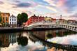 Leinwanddruck Bild - Night view of famous illuminated Ha Penny Bridge in Dublin, Ireland at sunset