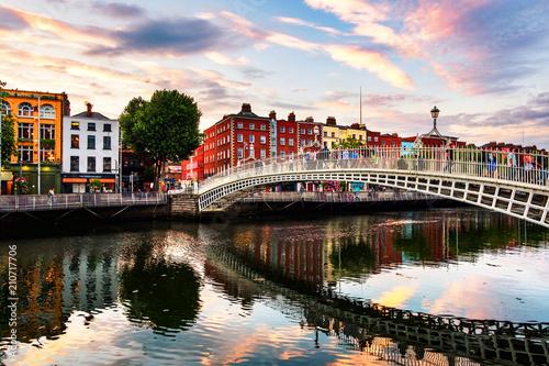 Leinwanddruck Bild Night view of famous illuminated Ha Penny Bridge in Dublin, Ireland at sunset