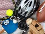 Used sports equipment placed on white rustic wooden background