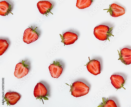 Halves of strawberries on the white background. - 210726382