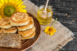 Beautiful transparent honey in bank, honeycombs and pollen on a wooden table. It can be used as a background - 210728368
