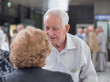 Senior man and woman talking