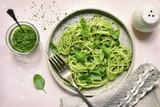 Spaghetti pasta with pesto sauce - traditional dish of italian cuisine.Top view. - 210744196