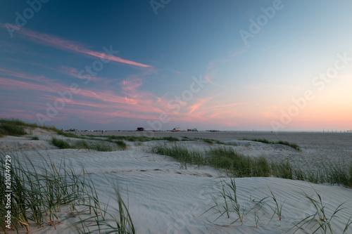 Fotobehang Noordzee Sunset St. Peter-Ording beach