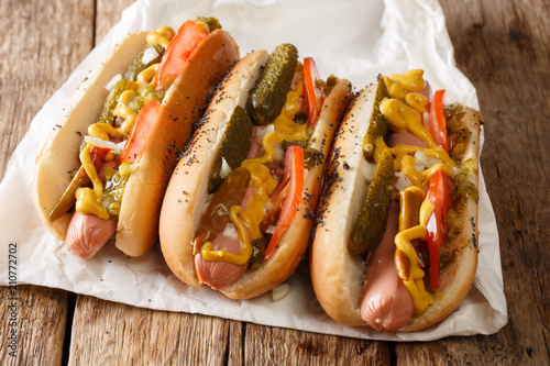 Fotobehang Chicago Delicious Chicago style hot dog with mustard, vegetables and relish close-up. horizontal