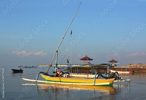 Fotobehang Bali Bali Outrigger Fishing Boats at Down, Sanur Indonesia.
