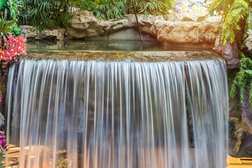 landscape of beautiful Waterfall in garden at public park