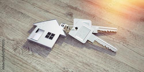 Leinwandbild Motiv Haus-Schlüssel auf Holz im Sonnenlicht