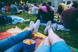 people watching movie in open air cinema in city park - 210807555