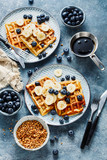Waffles with banana and fresh blueberries.