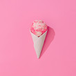Leinwanddruck Bild - Vanilla and strawberry ice cream in white ice cream cone on pastel pink background. Summer minimalism. Flat lay.