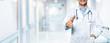 Leinwanddruck Bild - happy friendly doctor standing in hospital hallway. trust and partnership concept