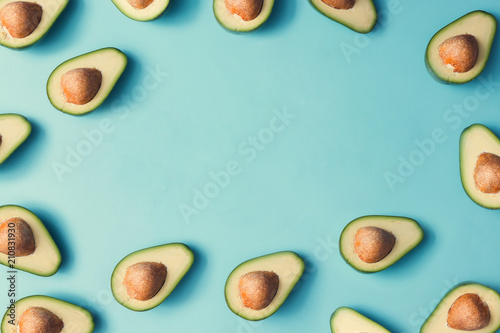 Avocado colorful pattern on a pastel blue background. Summer concept. Flat lay. - 210831930
