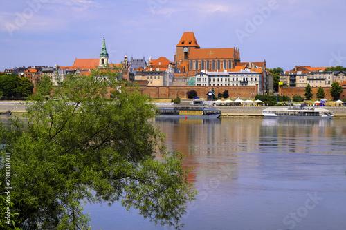 Fototapeta Torun, Poland - Panoramic view of historical district of Torun old town by the Vistula river