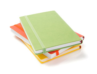 notebook and pad at white background