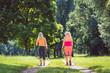 Leinwanddruck Bild - Mutter und Tochter beim Nordic Walking für bessere Fitness