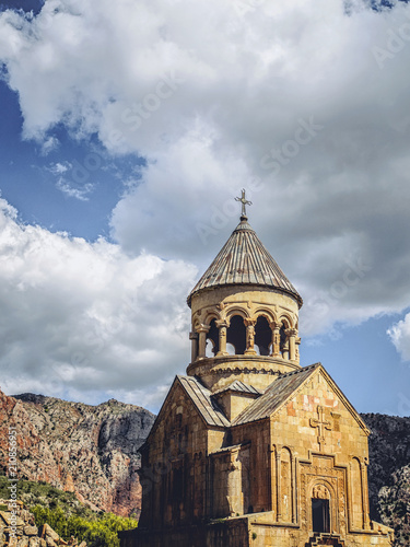 church tower in front of mountains and clouds - 210856951
