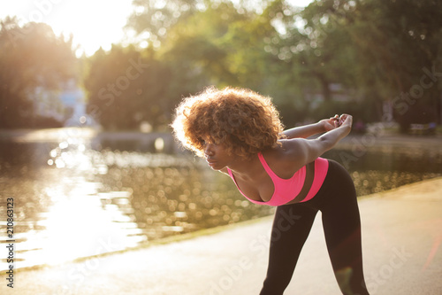 Wall mural Fit girl training outdoors
