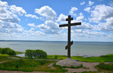 Orthodox cross on a hill on the lake - 210869962
