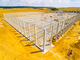 Aerial view of construction site. Industrial theme from drone. Industry, development and investment in European Union. - 210886137