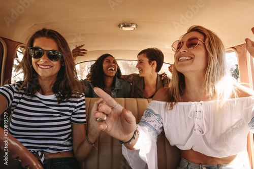 Wall mural Women enjoying themselves on a road trip