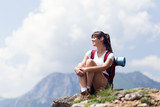 Successful female hiker enjoy the view hiking on mountain peak