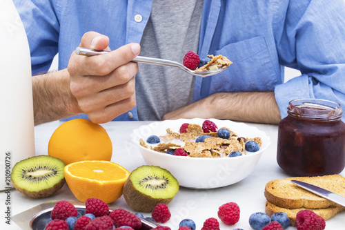 spoon with cereals and fruits, breakfast and healthy snack - 210900726