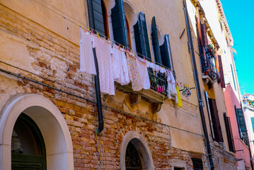 laundry hanging on the window, old architecture in Italy, Venice