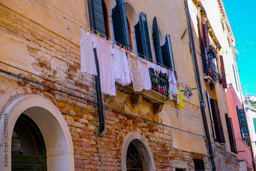 laundry hanging on the window, old architecture in Italy, Venice - 210908354
