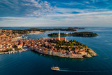 Beautiful Rovinj at sunset - HDR aerial view taken by a professional drone from above the sea. The old town of Rovinj, Istria, Croatia - 210917152