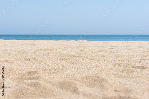 Foto Murales sea sand and blue sea background