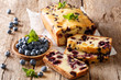 summer loaf of fresh blueberry muffin bread cake decorated with mint closeup. horizontal