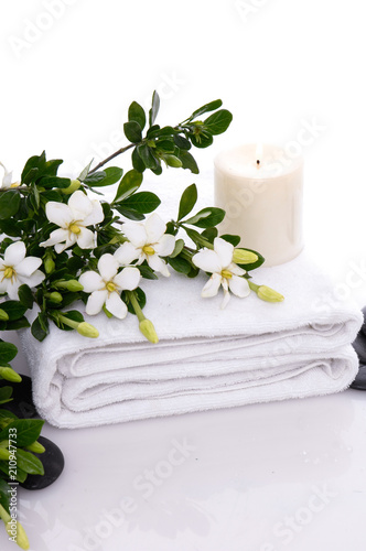 Aluminium Spa towel and candle and gardenia with black pebbles