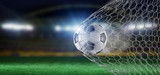 Football ball in the net of a goal - 3d rendering - 210948979