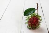 rambutan sweet fruit  on whit wooden teble - 210964995