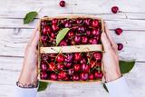 Freshly picked ripe sweet cherry in a basket.  - 210974376