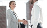 welcome and handshake business partners - 210974906