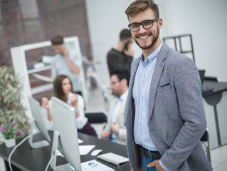 modern young businessman on the background of the workplace © FotolEdhar