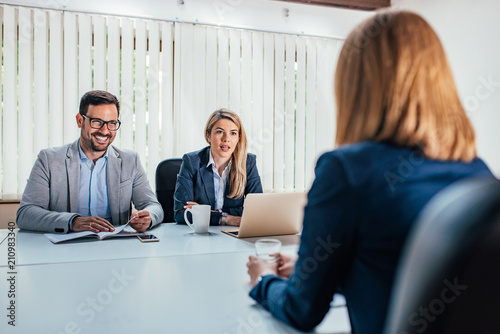 Foto Murales Business - young woman sitting in job interview.