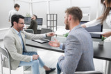 two businessmen talking in the office of the Bank. - 210983796