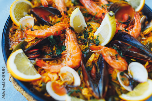 spanish seafood paella, closeup view - 210993530