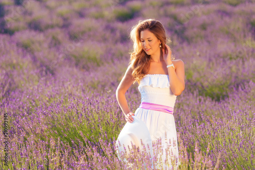 Young woman in lavender field © SasaStock