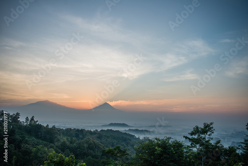 Mount Merapi erupting at sunrise