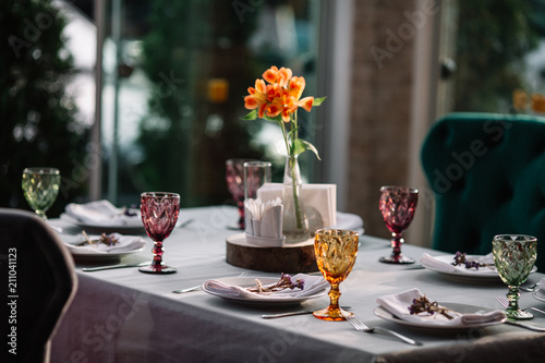 Fototapeta Table served for dinner with flowers on it